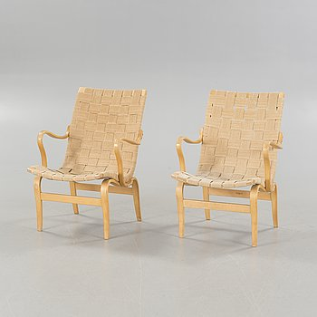 """A pair of """"Eva"""" armchairs by Bruno Mathsson for Firma Karl Mathsson in 1966."""