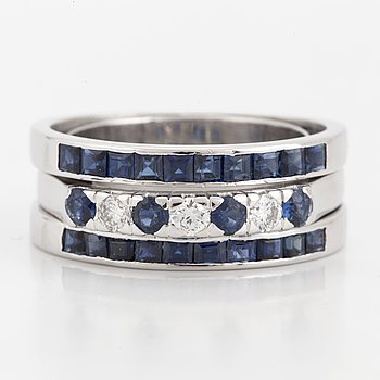 An 18K white gold, sapphire and diamond ring.