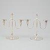 A pair of elis bergh silver plated candelabras, swedish grace, cg hallberg, stockholm, 1920s