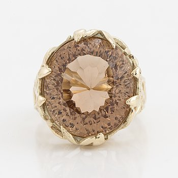 A 14K gold topaz ring.
