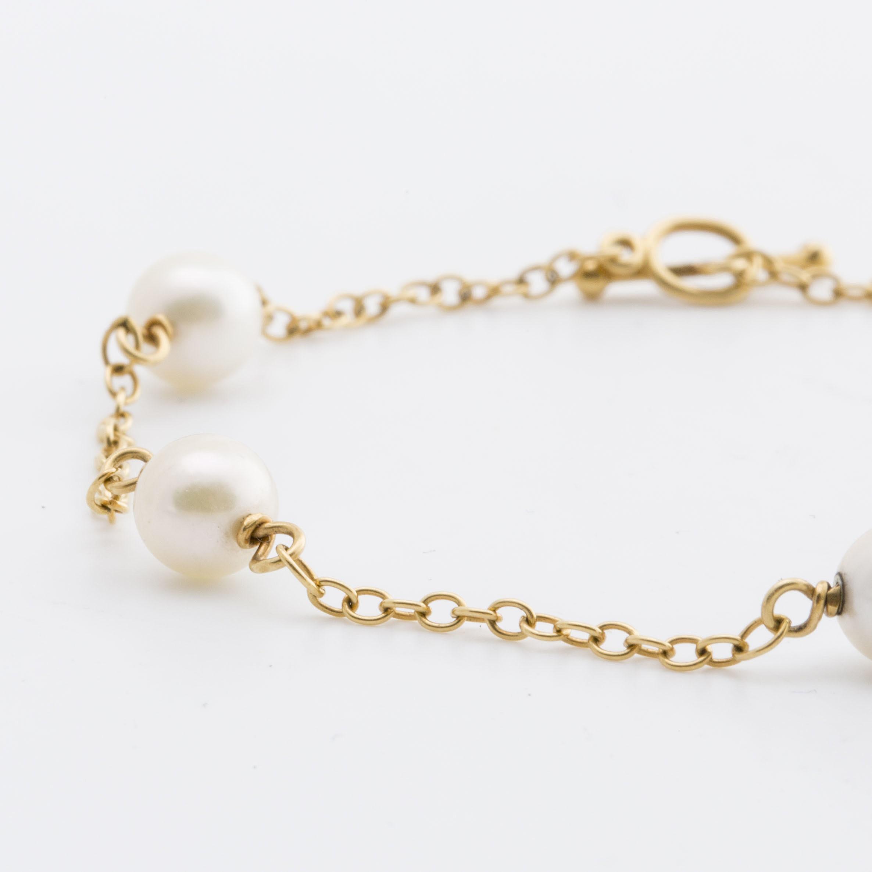 223e2f44b2e29 TIFFANY BRACELET 18K gold w 5 cultured pearls approx 5 mm, design ...