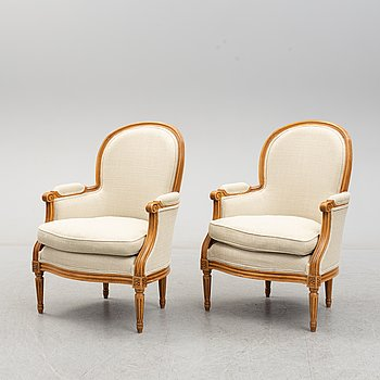 A pair of late 20th century beech easy chairs.