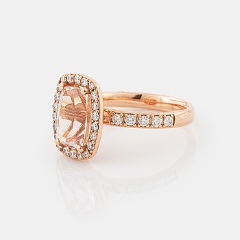 A morganite and brilliant cut diamond ring.