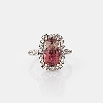 A tourmaline and brilliant cut diamond ring.