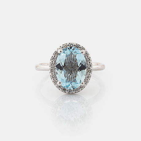 A aquamarine and brilliant cut diamond ring.