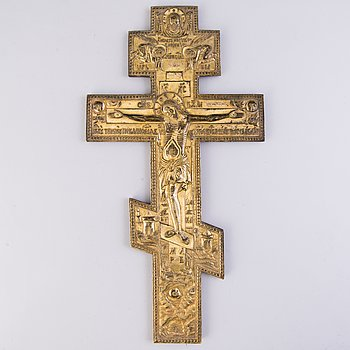 An late 19th Century orthodox cross in gilt brass.