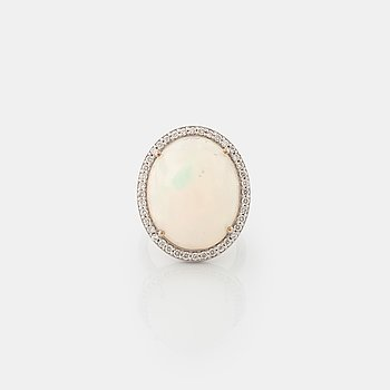A white opal and brilliant cut diamond ring.