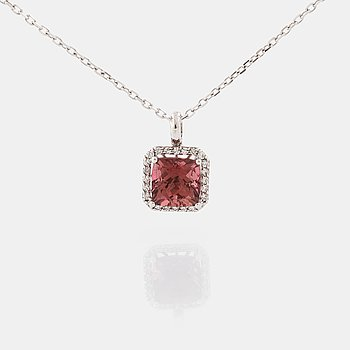A tourmaline and brilliant cut diamond pendant.