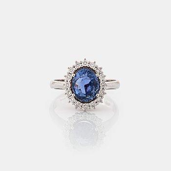 A sapphire and brilliant cut diamonds ring.