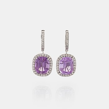A pair of amethyst and brilliant cut diamond earrings.