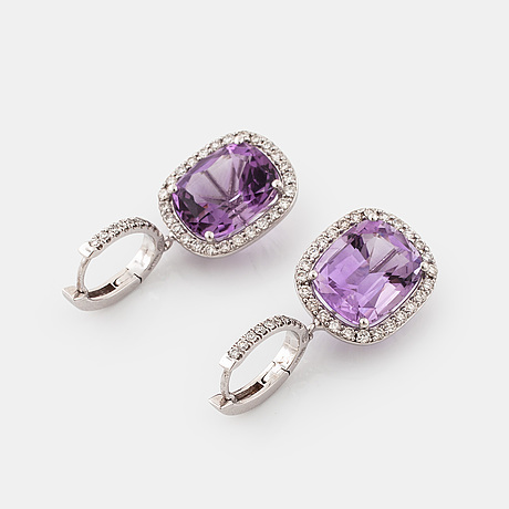 A pair of amethyst and brilliant cut diamond earrings