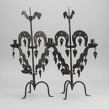 "KANDELABRAR , 2 st  smide, ""Tuppljusstake"" Design Gustaf Ancarkrona, Käck & Hedbys, Leksand."