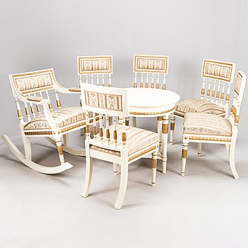 A mid-20th Century set of five chairs, a table and a rocking chair in Gustavian style.