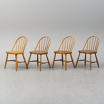 a set of four chairs from the mid 20th century.