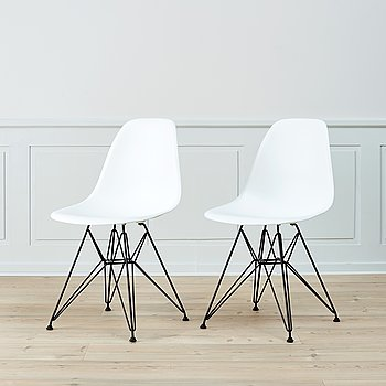 A pair of 'DSR' chairs by Charles & Ray Eames.