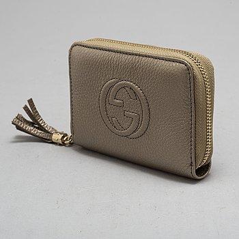 a Gucci wallet.