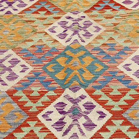 A kilim rug, 304 x 196 cm