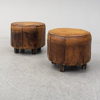 A pair of leather stools, late 20th century.