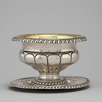 GUSTAF THEODOR FOLCKER, a parcel-gilt silver sauce bowl and stand, Stockholm, 1841.