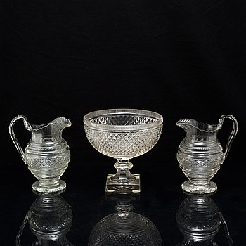 A set of two cut glass ewers and a bowl, circa 1900.