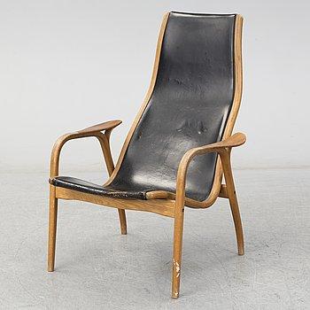 YNGVE EKSTRÖM, a teak and oak 'Lamino' easy chair from Swedese.
