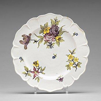 301. A set of nine faience Rörstrand plates, 18th Century.