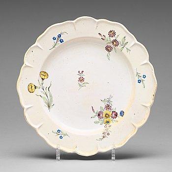 302. A set of six odd Swedish faience plates, Marieberg and Rörstrand, 18th Century.
