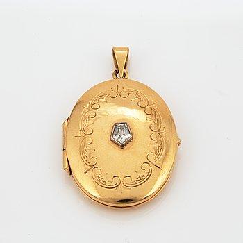 MEDALJONG,  18K guld och diamant.