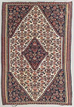 A semiantique Senneh carpet ca 168 x 113 cm.