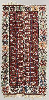 A semiantique Kilim ca 330 x 161 cm.