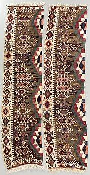 A pair of Anatolia antique Kilims ca 340 x 86 cm each.