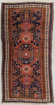 An antique Kurdistan carpet ca 250 x 133 cm.