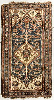 A probably later part of the 19th century Kurd carpet ca 190 x 116 cm.