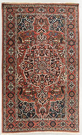 An antique bachtiari carpet ca 205 x 134 cm.