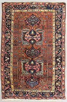An antique Hamadan carpet ca 199 x 129 cm.
