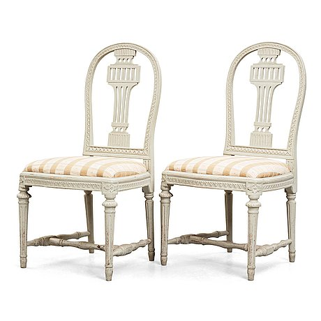 A pair of late gustavian late 18th century chairs.