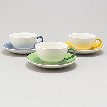 WILHELM KÅGE, a set of three porcelain teacups, Gustavsberg.