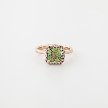 A tourmaline and a brilliant cut diamond ring.