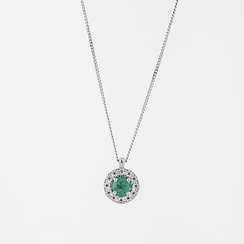 An emerald and brilliant cut diamond pendant.