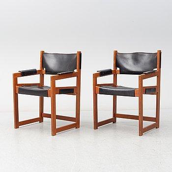 SVEN KAI-LARSEN, A pair of teak and leather armchairs from Rälta snickeri, 1960's.