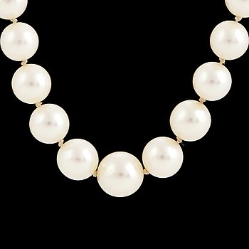 A cultured salt water pearl necklace, gold clasp.