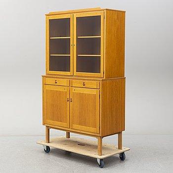 A second half of the 20th century oak veneered display cabinet.
