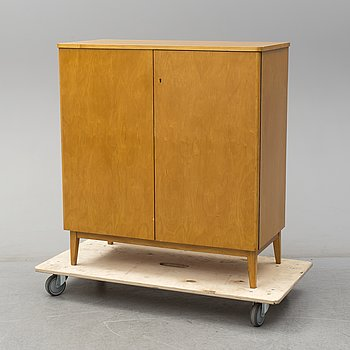 A second half of the 20th century beerch veneered Nordiska Kompaniet cabinet.
