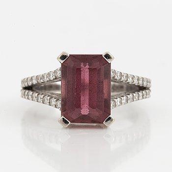 An emerald-cut pink tourmaline and diamond ring.