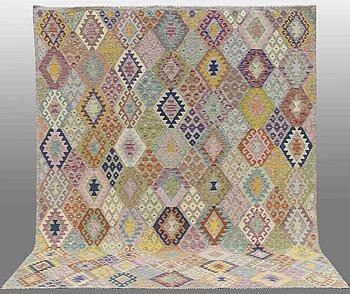 A CARPET, kilim, around 351 x 277 cm.