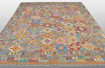 A carpet, kilim, around 356 x 257 cm.