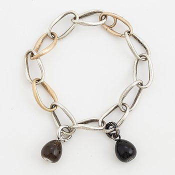 An Ole Lynggaard 'Love ring' bracelet, with two 'Sweet drops' charm.