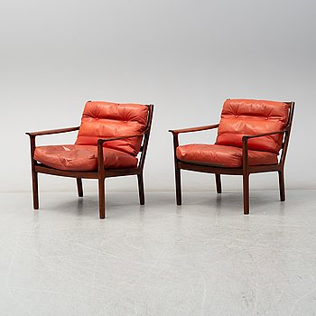 A pair of No 935 rosewood easy chairs by Fredrik A Kayser, Vatne Möbler, Norway.