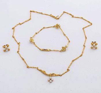 LAPPONIA, parure, 18K gold and cultured pearls approx 3 mm, design Björn Weckström 1999, certificate and original box.