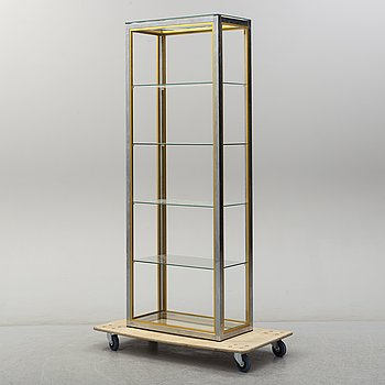 A glass book case from the late 20th century.